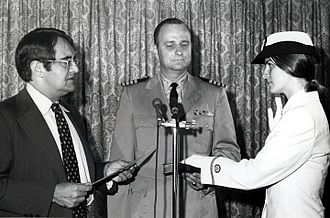 Peter George Peterson - Peterson swearing in, Cmdr. Pam Chelgren-Koterba, the first woman officer of the NOAA Corps (1972).