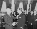 Photograph of President Truman shaking hands with Lt. Donald A. Gary (engineering officer of the U.S.S. FRANKLIN) as... - NARA - 199311.tif