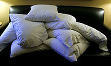 a pile of pillows on a couch
