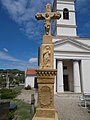 Porel crucifix (1876) before the Exaltation of the Cross chapel in Vonyarcvashegy, 2016 Hungary.jpg