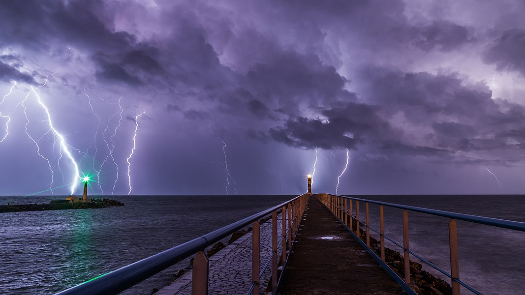 Port and lighthouse overnight storm with lightning in Port-la-Nouvelle in the Aude department in southern France.
