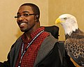 Posing for picture with Bald Eagle. (10593980476).jpg