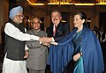 Pranab Mukherjee, the Prime Minister, Dr. Manmohan Singh and the Chairperson, National Advisory Council, Smt. Sonia Gandhi with the winner of Indira Gandhi Prize for Peace, Disarmament and Development.jpg
