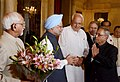 Pranab Mukherjee being greeted by the Vice President, Shri Mohd. Hamid Ansari, the Prime Minister of India, Dr. Manmohan Singh and the Union Minister for New and Renewable Energy, Dr. Farooq Abdullah.jpg