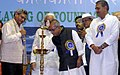 Pranab Mukherjee lighting the lamp at the foundation stone laying ceremony for the development and modernisation of NSCBI Airport in Kolkata. The Union Minister for Civil Aviation.jpg