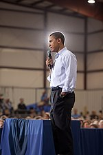 President Barack Obama addresses a town hall meeting on health care insurance reform inside a hangar at Gallatin Field in Belgrade, Mont., on Aug. 14, 2009