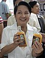 President Gloria Macapagal-Arroyo shows a bottle of Sukang Pinakurat.jpg