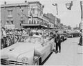 President Harry S. Truman and four other men riding in a convertible down a main street in Bolivar, Missouri. The... - NARA - 199911.tif