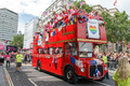 Pride in London 2016 - Ensignbus with 'We Stand with Orlando' banner.png