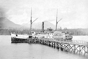 Comox, British Columbia - Before railways and highways reached Comox, mail and supplies were provided by steamboats, such as the sidewheel Princess Louise, shown at the end of the Comox Wharf on August 20, 1879