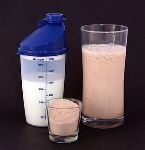 Human nutrition - Protein milkshakes, made from protein powder (center) and milk (left), are a common bodybuilding supplement.