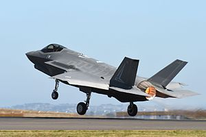 Colour photograph of a modern jet fighter aircraft taking off from a runway