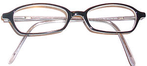 Horn-rimmed glasses - A pair of horn-rimmed glasses c. 2000