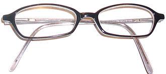 Horn-rimmed glasses - A pair of horn-rimmed glasses c. 2000