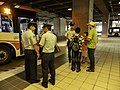 ROCAF Sergeants and Shuttle Bus in Buses Terminal of THSR Taichung Station 20140719.jpg