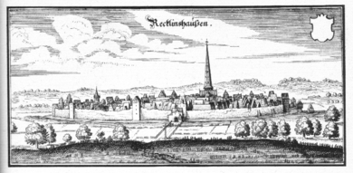 Meadows surround a fortified city, protected by thick walls, artillery towers, and a wide moat. The countryside around the city was flat, giving the inhabitants of the city, and the soldiers on its walls, an advantage of height. A church spire towers over the city and dominates the landscape.