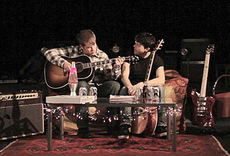 """Richard Barone - Richard Barone (right) and frequent collaborator Matthew Billy on the set of the """"Hey, Can I Sleep On Your Futon?"""" video in April 2012."""
