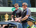 Richie McCaw signing autograph next to Webb Ellis Cup and Ian Foster (2015 RWC All Blacks victory parade in Wellington).jpg