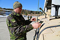 Romanian Land Forces Staff Sgt. Adrian Calota mounts multiple integrated laser engagement system gear on a Humvee during a mission rehearsal exercise at the Joint Multinational Readiness Center in Hohenfels 130305-A-ZD093-012.jpg