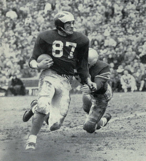 Ron Kramer - Advancing against Ohio State in 1955