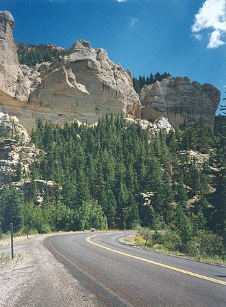Utah State Route 143 - White cliffs and forest on the way up Parowan Canyon