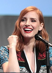 A head shot of Chastain as she laughs away from the camera