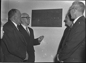Bob Heffron - Heffron (centre) unveils the 'George Booth Assembly Hall' at the newly opened Kurri Kurri High School, 9 September 1956.