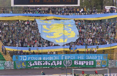 Fans of the FC Karpaty Lviv football club honouring the Nazi Waffen-SS Galizien division, in Lviv, Ukraine, 2013 SS-Galizien-Banner.jpg