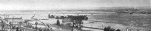 Sault Ste. Marie Bridge Company - Shot of the rail bridge in 1905, showing the 10 original Warren truss spans. The highway bridge has not yet been built.