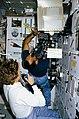 STS-31 MS Sullivan & Pilot Bolden monitor SE 82-16 Ion Arc on OV-103 middeck.jpg