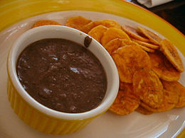 A bean dip served with plantain chips