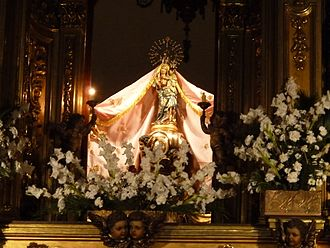 Banner of Misericordia - The image of the Virgin in the sanctuary with her mantle extended, like the one that crowned the banner