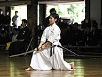 Japanese girl practicing Iaido with a custom made katana.