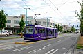 Seattle SLU Streetcar - purple car 303 laying over at N. end of line, center of Fairview Ave (2008).jpg