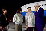Secretary Kerry Smells a Traditional Lei Presented to him by Filipino Protocol Officials at the Villamor Airport in Manila (28531066856).jpg