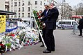 Secretary Kerry and French Foreign Minister Fabius Straighten the Ribbons on a Wreath They Laid at Hyper Cacher Kosher Grocery Store in Paris (16104894220).jpg