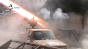 Sham Legion - Sham Legion multiple rocket launcher mounted on a technical launch rockets at YPG positions in Aleppo, 2 October 2015.