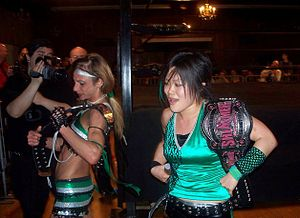 Honor Takes Center Stage - Daizee Haze and Tomoka Nakagawa after winning the Shimmer Tag Team Championship.