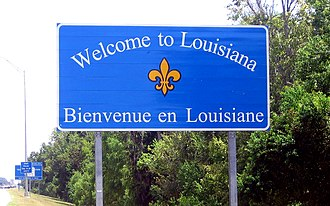 Louisiana's bilingual state welcome sign, recognizing its French heritage Signalisation routiere bilingue a l'entree de la Louisiane.jpg