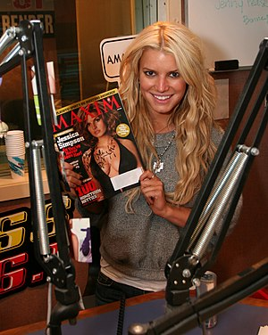 Jessica Simpson holds a Maxim Magazine with he...