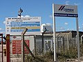 Signs at the entrance to an aggregate depot - geograph.org.uk - 563144.jpg