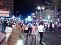 Simchat Torah Rabin square 2016 on road dancing.jpg