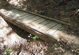 Timber bridge Bridge that uses timber or wood as its principal structural material