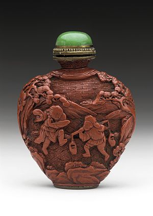 Snuff (tobacco) - Chinese snuff bottle made of carved lacquer and jade, ca. 18th century