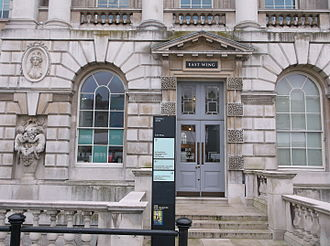 """Rustication (architecture) - Courtyard of Somerset House in London, mostly smooth-faced """"V"""" joints, but with vermiculated square blocks around the Gibbs surround to the door."""