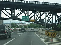 The New Jersey Turnpike is shoehorned under the Skyway.