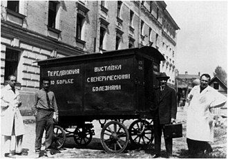 State Venereological Institute - Volf Bronner (right) with Soviet anti-syphilis propaganda wagon outside the State Venereological Institute, 1926