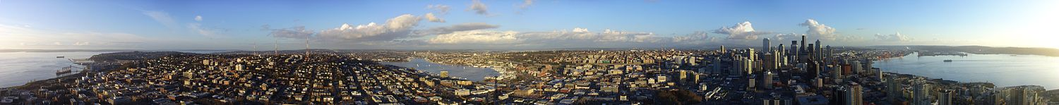 English: Seattle seen from the top of the Space Needle (Puget Sound to the left and right, Lake Union in the Center)