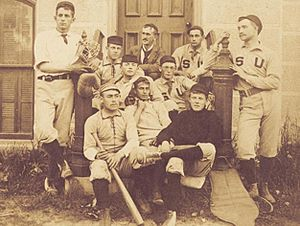 Stephen Crane - Stephen Crane (front row, center) sits with baseball teammates on the steps of the Hall of Languages, Syracuse University, 1891. (Photo courtesy of the SU Special Collections Research Center)