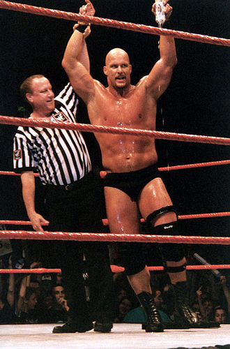 Stone Cold Steve Austin - Austin celebrates with referee Earl Hebner